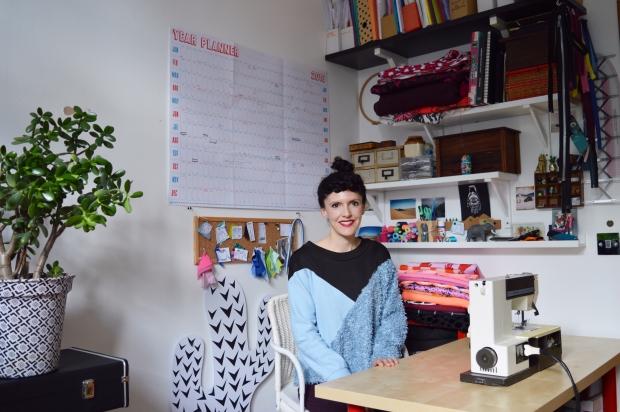 Rosie Martin - smiling at desk
